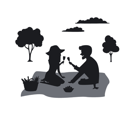 Silhouette of a couple on a picnic in the park Vectores