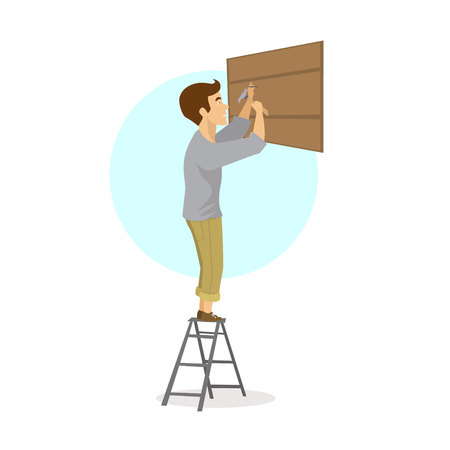 木製板に釘を打つ男、建物を修復