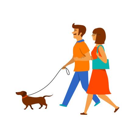 coppia, uomo e donna che camminano con il loro animale domestico, cane bassotto