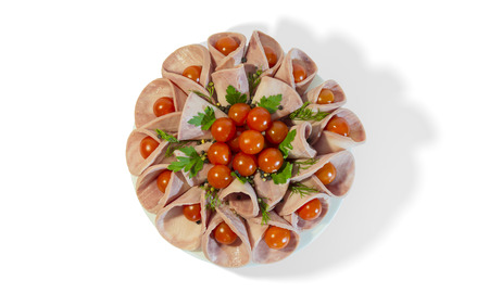 Dish with sausage and cherry tomatoes on a plate