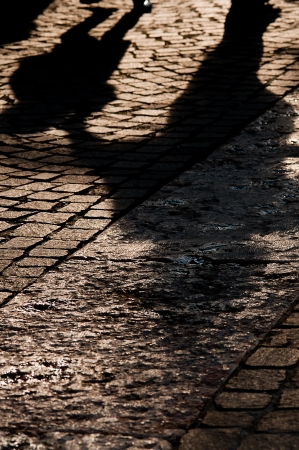 two shadows on a cobblestone on a street in rome Banque d'images
