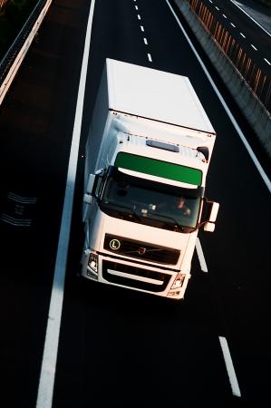 truck running on highway in Italy
