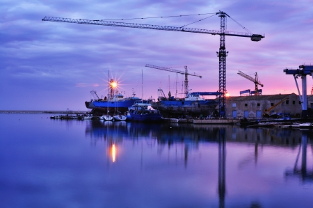 Cranes on Harbour at sunset  One of the many Sicilian shipyards