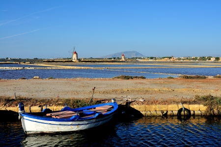 landscape in the salt pans of Trapani with the windmills on the horizon photo