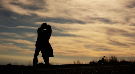 Silhouettes of a man and a woman kissing photo