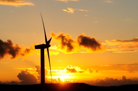 Windturbine at sunset in Sicily countryside photo