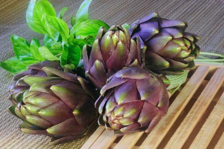 Artichoke seasonal vegetables on the kitchen table
