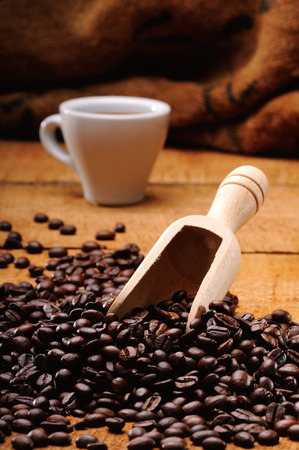 a hot cup of black coffee with coffee beans photo