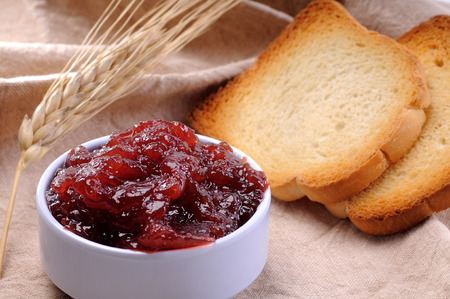 crisp toasts with strawberry jam homemade photo