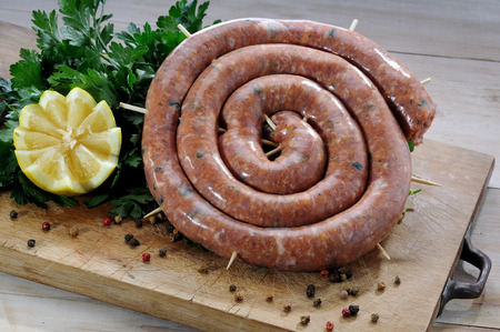 A roll of pork sausage, typical of Sicilian cuisine photo
