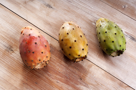 Tropical Opuntia Prickly Pear fruit on wooden background