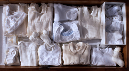 drawer full of clothes for a baby coming Stock Photo