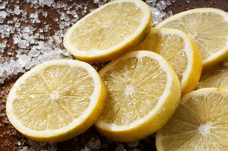 lemon slices: fresh lemon slices on the table with salt