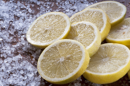 fresh lemon slices on the table with salt photo