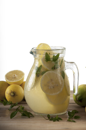 Lemonade with mint in a jar and lemon with clipping path photo