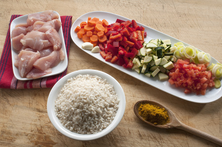 raw ingredients ready to prepare chicken curry with vegetables photo