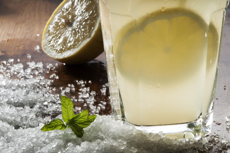Preparation of the lemonade drink with mint and salt on the table photo