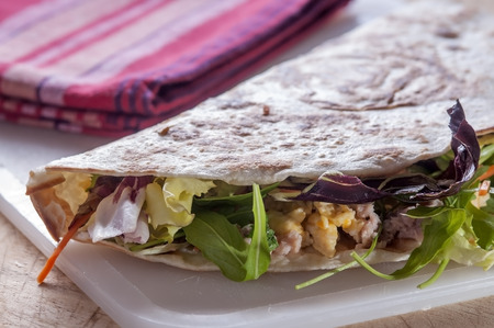 tunafish: flatbread with tuna eggs and lettuce typical Italian food in northern Italy