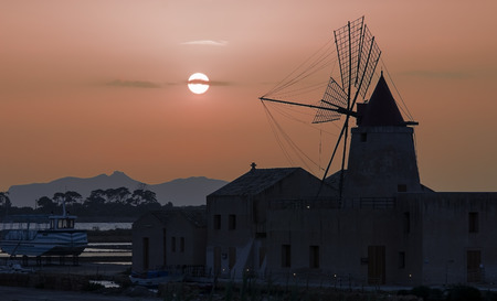 egadi: Windmill in the bay of salt marshes of Marsala in front of Egadi Islands in Sicily