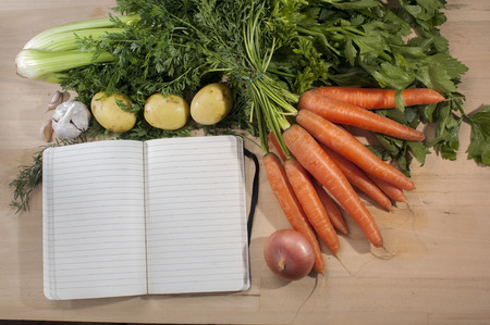 block note: Recipe block note template on wooden cutting board with vegetables