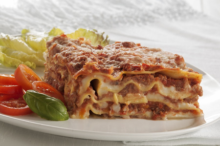lasagna is a typical Italian meal, made with fresh pasta baked with meat sauce and bechamel sauce