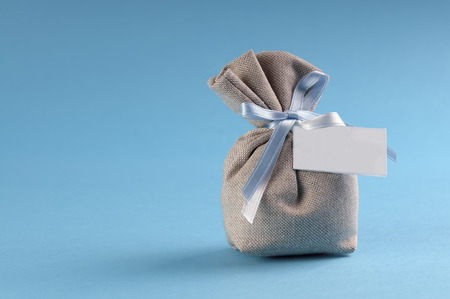 bag with sugared almonds called dragees to announce a new birth with copyspace photo