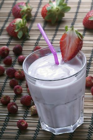 nourishing: classic strawberry milkshake nourishing and gentle with her pretty pink color Stock Photo