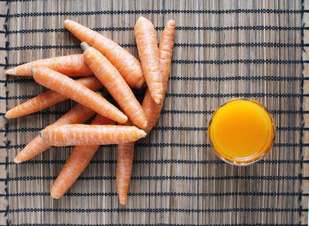 radicals: Carrots are an excellent source of beta-carotene, an antioxidant very effective in combating free radicals Stock Photo