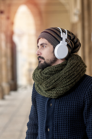 a young man listens to music in an urban image of modern life