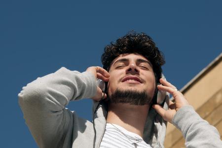 closing eyes: Man enjoying the moment listening to music closing eyes