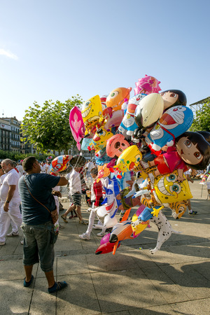 feast: Pamplona Navarra Spain 11 July  2015, S Firmino fiesta  salesman of balloons for the feast in main square for ENCIERRO that  is a deeply rooted celebration start every year from 6 July with pyrotechnic CHUPINAZO until 14 July Editorial