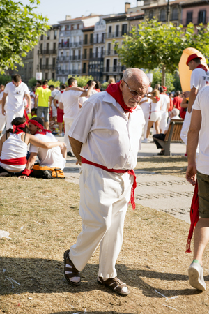 hemingway: Pamplona Navarra Spain 11 July  2015, S Firmino fiesta an old man crossing the main square dressed in traditional clothes of the runners with the bulls. ENCIERRO is a deeply rooted celebration start every year from 6 July with pyrotechnic CHUPINAZO until