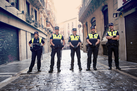 hemingway: Pamplona Navarra Spain 12 July   2015, S Firmino fiesta police stop the bulls runners before the race start. ENCIERRO is a deeply rooted celebration start every year from 6 July with pyrotechnic CHUPINAZO until 14 July