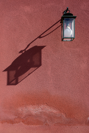 mediterranean house: Old Lantern on orange Concrete wall in a mediterranean house Stock Photo