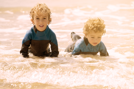 brothers playing: two brothers playing on the shore in a sunny day