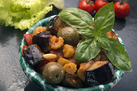 caper: Sicilian eggplant caponata is a salad with tomatoes vinegar pine nuts caper celery onions olive oils weet and sour sauce Stock Photo