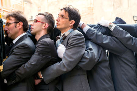 Trapani, Sicily, Italy - March 26, 2016 Good Friday processionfor holy week in Trapani. Every year is staged the passion of Christ in a procession which lasts through the afternoon and night until next dawn. very heavy statuary groups are carried on the s