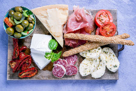 typical Mediterranean Italian appetizer based on cured meats, sausages, olives and cheese