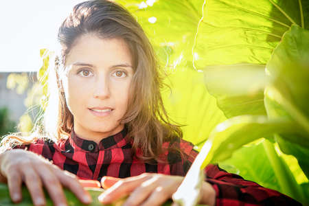 portrait of a beautiful woman among the plants concept of ecology and peace
