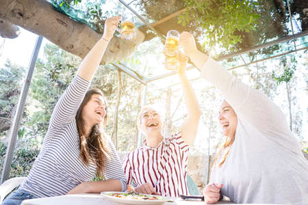 group of young friends free celebrate happy freedom toast with beer stein