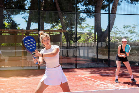 padel tennis women play on an outdoor court in summer Banque d'images