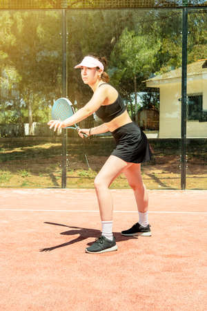 padel tennis woman play on an outdoor court in summer