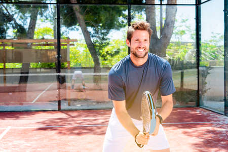 young guy plays padel tennis outdoor summer sport court getting fit Banque d'images