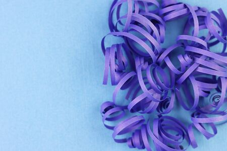 blue voluminous paper curls on a blue background. paper decorations for the background