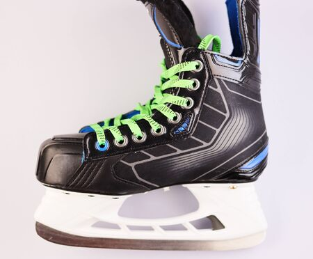 men's ice hockey skates isolate on a white background. black skates with green laces
