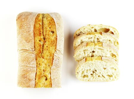 rectangular loaf of bread isolated on a white background, top view. baguette of whole and cut bread