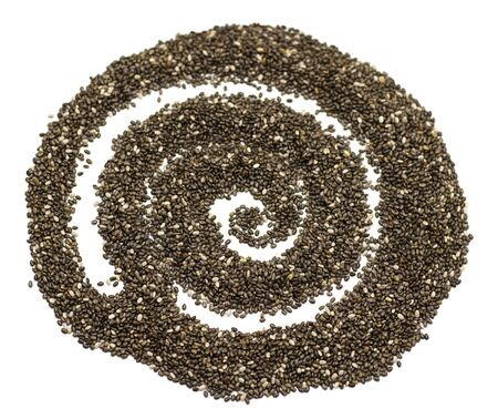 dark Chia seeds in the form of an abstract spiral isolated on a white background. small grains of Spanish sage, similar to beans, gray-white-black color with a relief pattern. health product