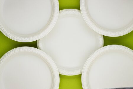 Eco-friendly biodegradable paper plates on a green background. preserving the purity of nature. the rejection of the plastic Stock fotó
