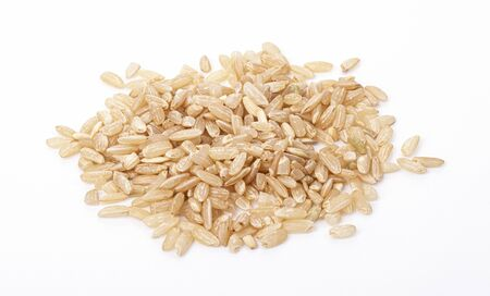 raw brown rice isolated on a white background. useful food for weight loss and health. good nutrition