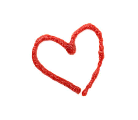 red heart of ketchup isolated on a white background. tomato sauce heart for Valentine's day